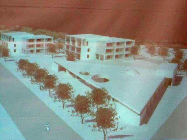Havainnekuva näyttää, että asuntola tulee Rasinkujan ja Tapaninvainiontien kulmaan, kerrostalot sen taakse.